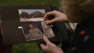 A person looks at photographs in an album