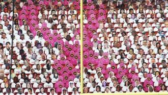 Washington Football Team fan cutouts form a Breast Cancer Awareness Ribbon during an NFL game