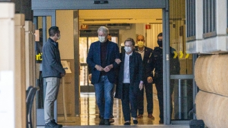 Former President Bill Clinton and former U.S. Secretary of State Hillary Clinton leave a hospital