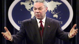Former Secretary of State Colin Powell talks at a news conference in 2001.