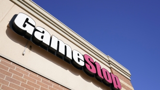 In this Thursday, Jan. 28, 2021 file photo, a GameStop sign is seen above a store, in Urbandale, Iowa.