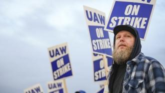 John Deere employees picket outside John Deere Davenport Works