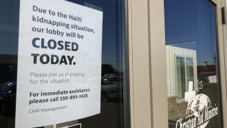 """A """"closed"""" sign at The Christian Aid Ministries headquarters in Berlin, Ohio."""
