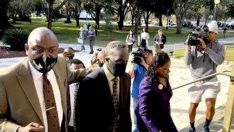 Ahmaud Arbery's father Marcus Arbery heads into the Glynn County Courthouse