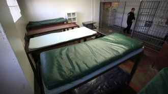 double-tiered bunks are seen in a jail cell