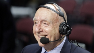 Sportscaster Dick Vitale broadcasts