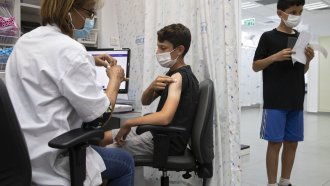 a youth receives a Pfizer-BioNTech COVID-19 vaccine