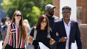 Former NFL players Ken Jenkins, right, and Clarence Vaughn III, center right, along with their wives