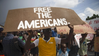 People protest for the release of kidnapped missionaries in Haiti.