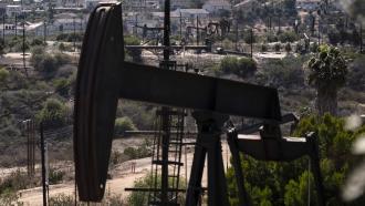 Pump jacks operating at the Inglewood Oil Field in Los Angeles, California.