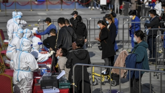 Chinese residents line up for COVID-19 testing.