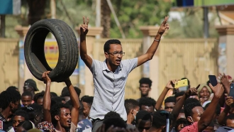 Thousands of pro-democracy protesters take to the streets in Sudan.