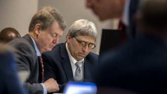 """William """"Roddie"""" Bryan, center, sits next to his attorney Kevin Gough during jury selection for the trial ."""