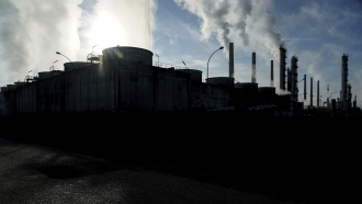 Smoke rises from the Feyzin Total refinery chimneys, outside Lyon, central France.