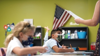 Students wear masks on the first day of school in Miami.