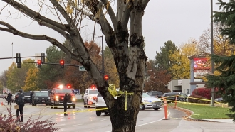 Police close off a street outside a shopping mall after a shooting in Boise, Idaho