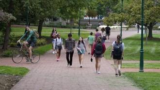 Students walk through university campus.