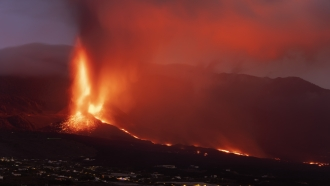 Lava erupts from a volcano on the Canary Island of La Palma, Spain, Tuesday, October 26, 2021.