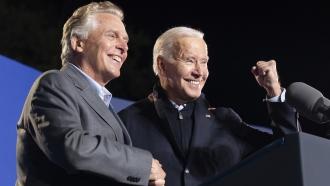 President Joe Biden, right, and former Virginia Gov. Terry McAuliffe, left