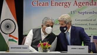 Indian Environment Minister Bhupender Yadav and U.S. climate envoy John Kerry
