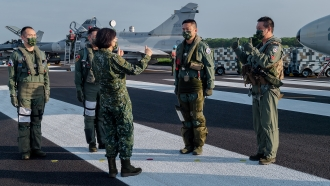 Taiwanese President Tsai Ing-wen with military personnel.