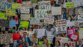 People protesting at New York City Hall against Mayor Bill de Blasio's plan to phase out the Gifted and Talented program.