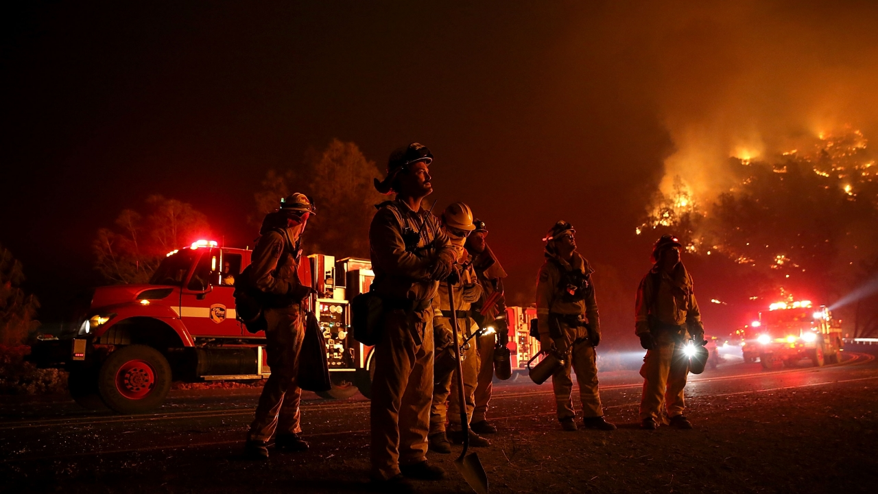 Firefighters monitor a California wildfire in 2015.