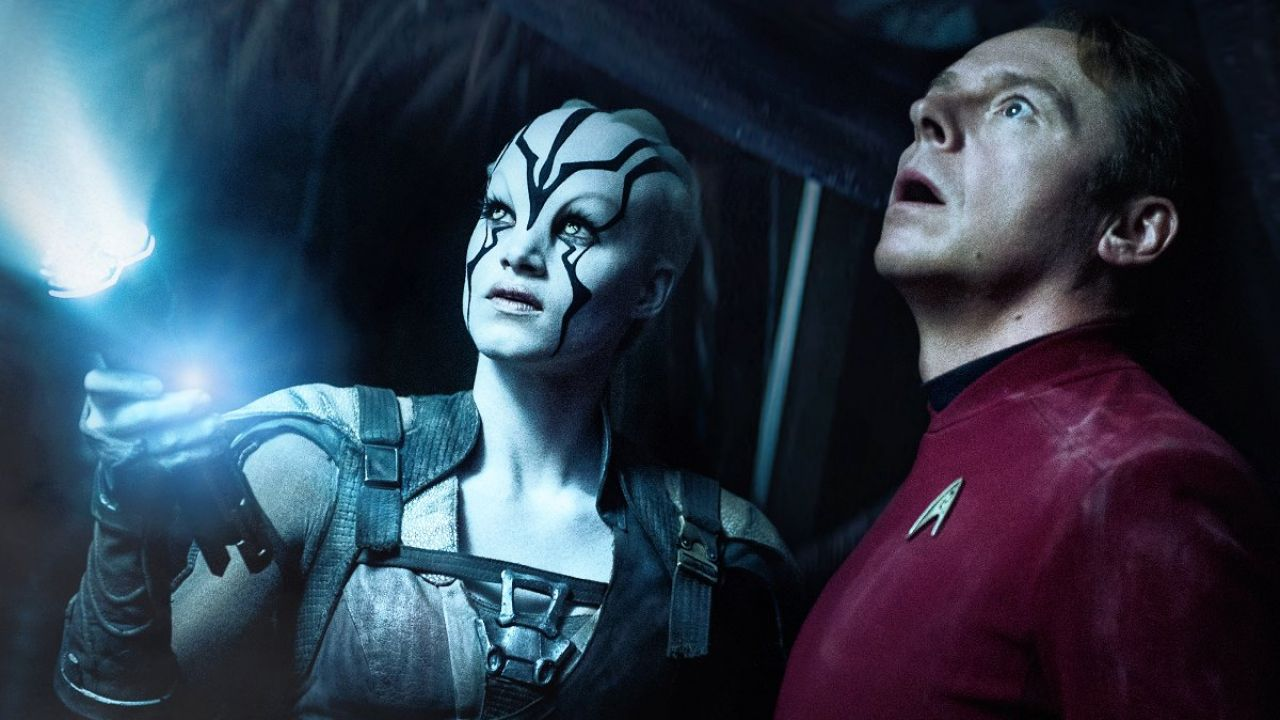 Sofia Boutella as Jaylah, a pale-skin alien with face markings, and Simon Pegg as Montgomery Scotty Scott in Star Trek Beyond