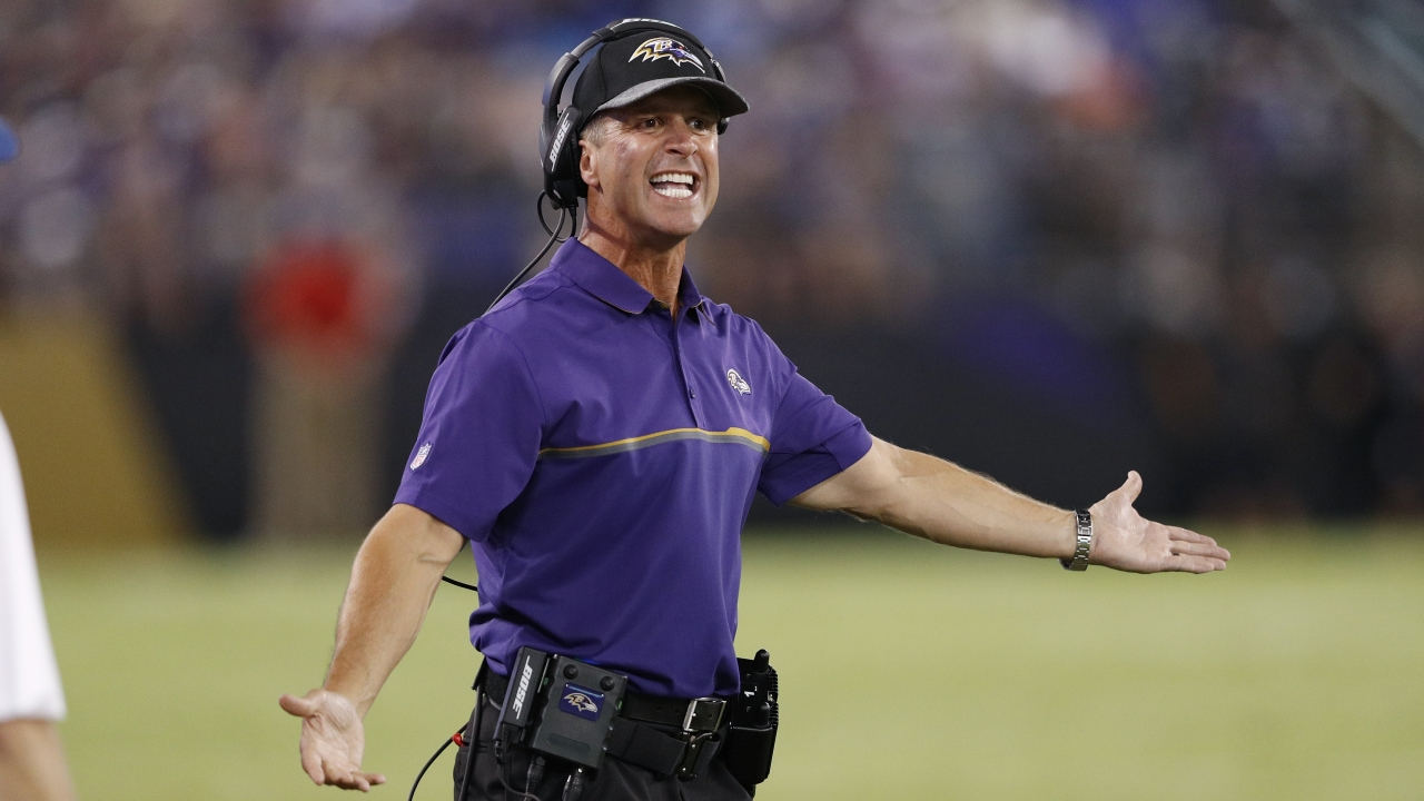 Ravens coach John Harbaugh gestures on the sideline during a preseason game.
