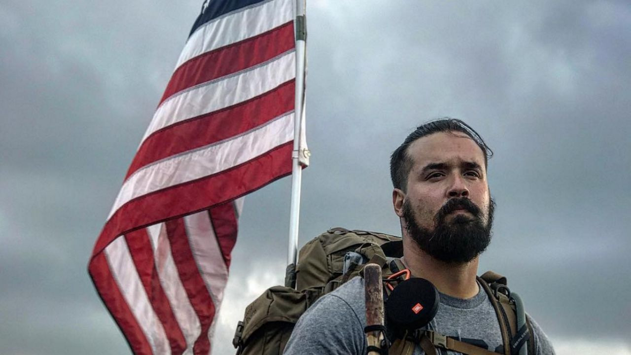 Ernesto Rodriguez holding an American flag