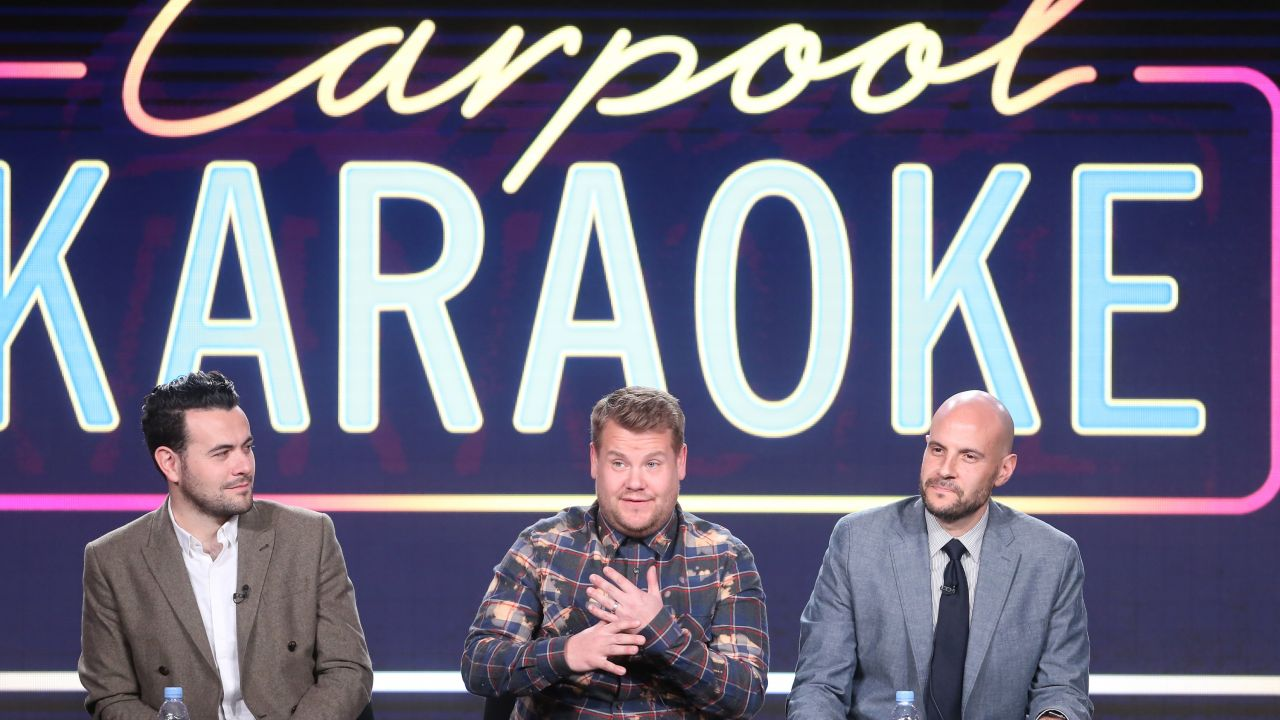 James Corden and two Carpool Karaoke executive producers on stage