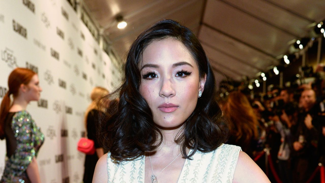 Constance Wu poses on the red carpet.