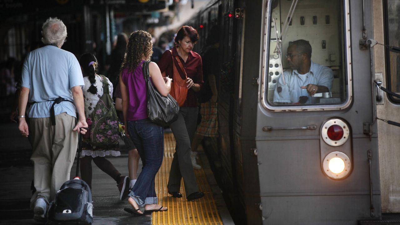 People get on a subway car in New York City