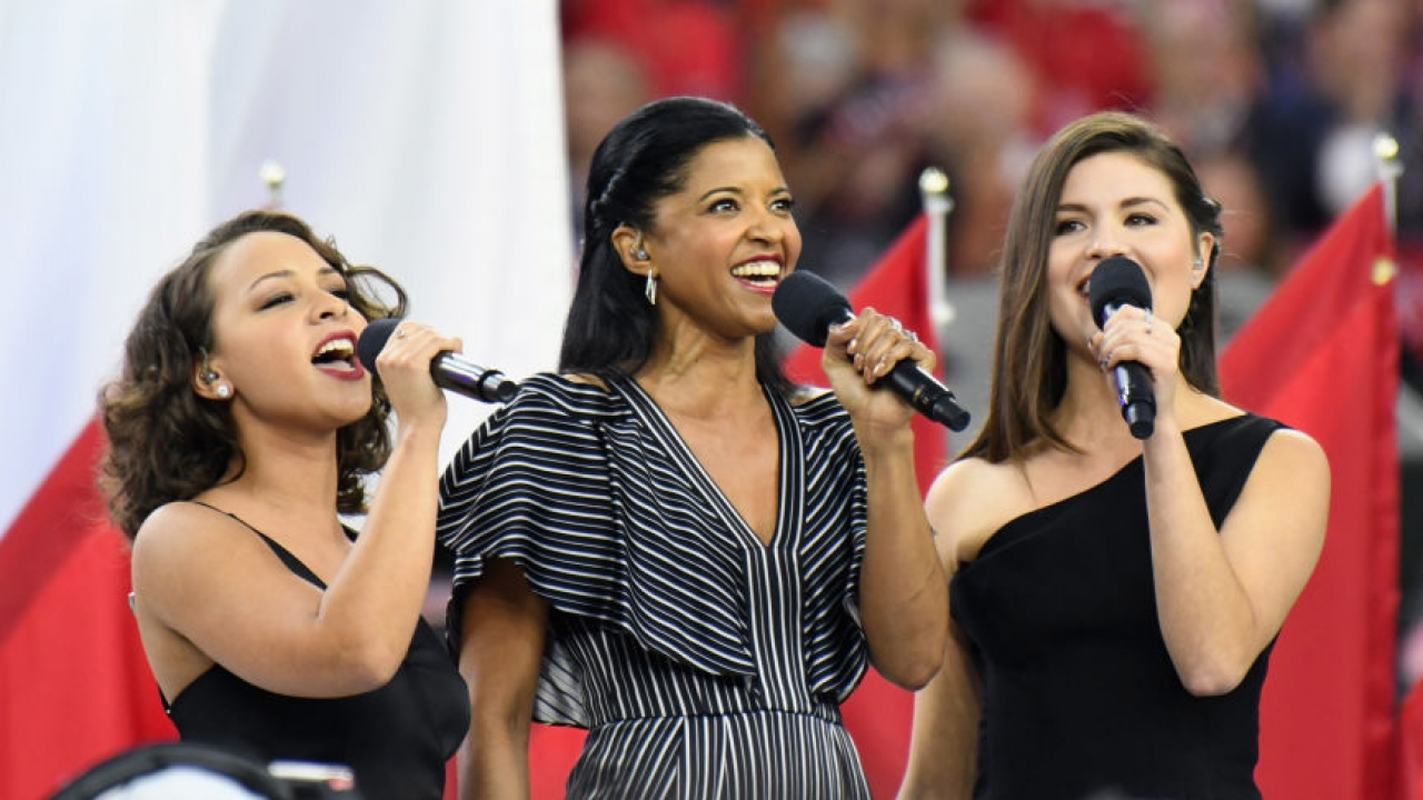 Phillipa Soo, Renée Elise Goldsberry and Jasmine Cephas Jones singing at Super Bowl LI.