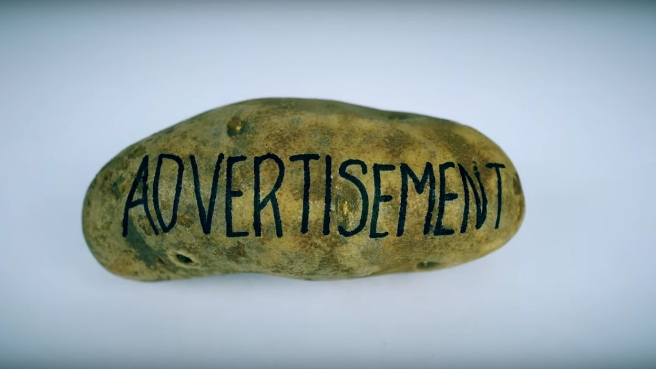 "A potato with the word ""advertisement"""