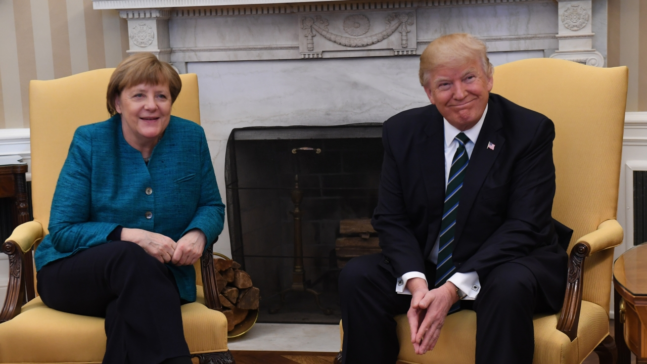 German Chancellor Angela Merkel sits with U.S. President Donald Trump.