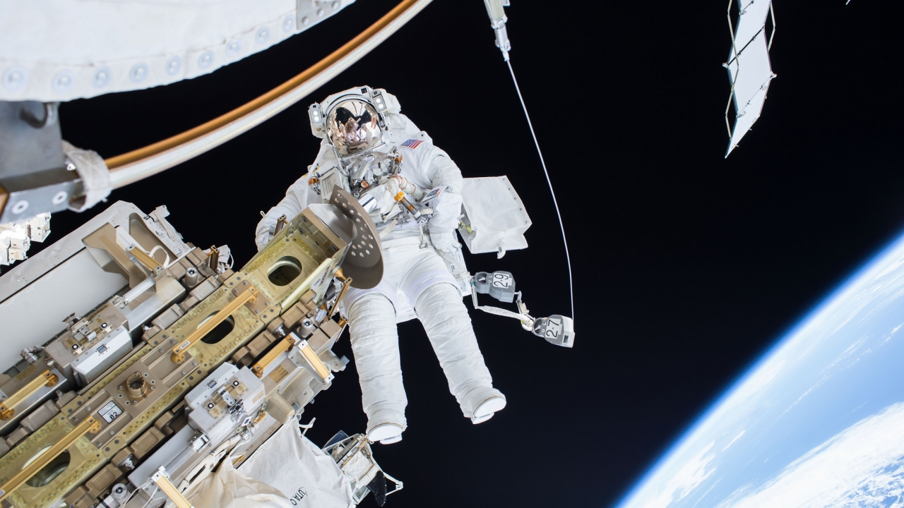 Astronaut performing spacewalk outside of International Space Station