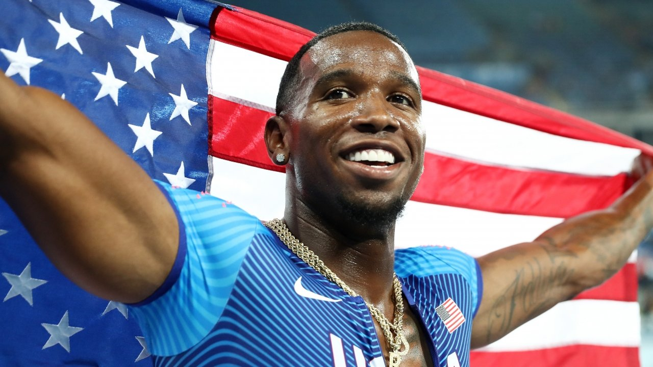 Gil Roberts of the United States celebrates after winning a gold medal.
