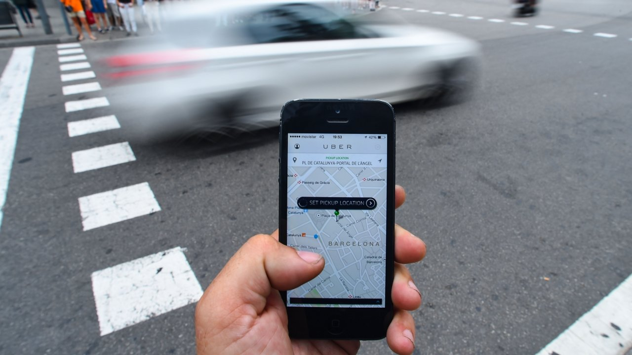 A rider uses the Uber app.