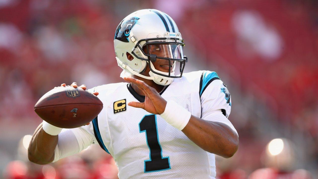 Cam Newton throws a pass.
