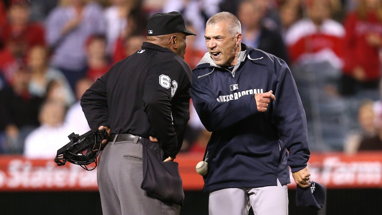 Yankees manager Joe Girardi argues with an umpire.