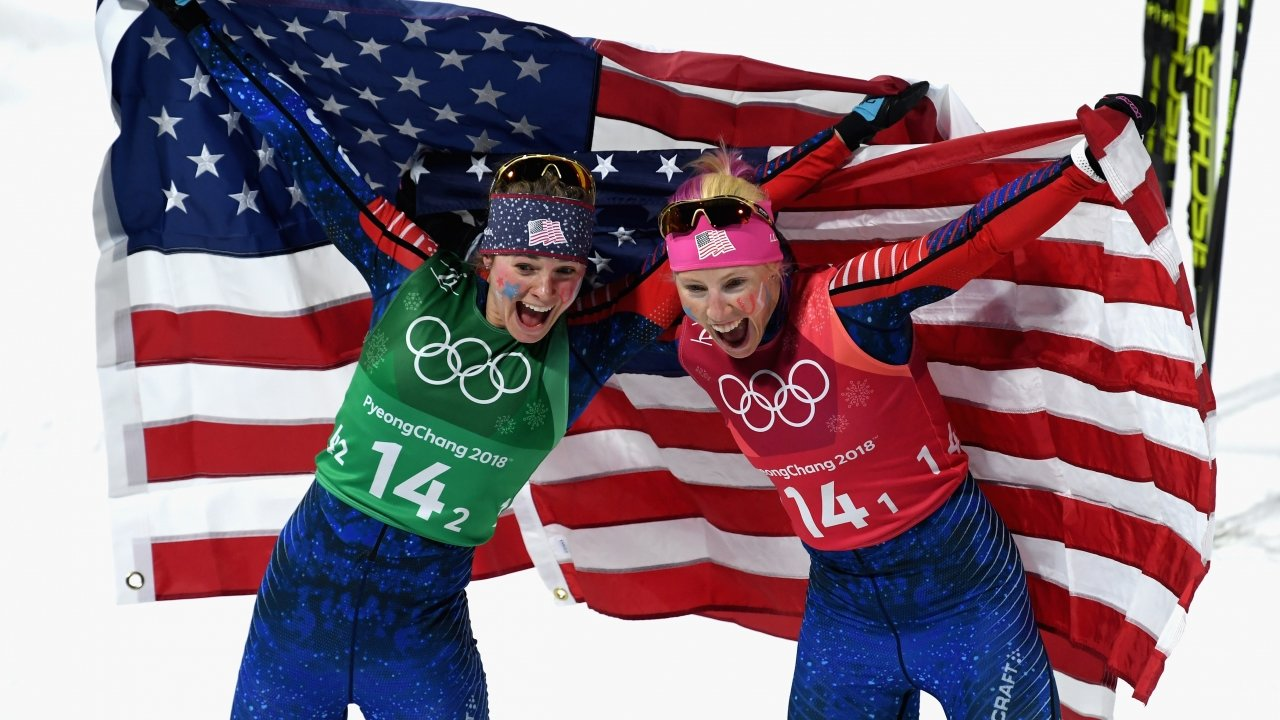 Jessica Diggins of the United States and Kikkan Randall of the United States celebrate.
