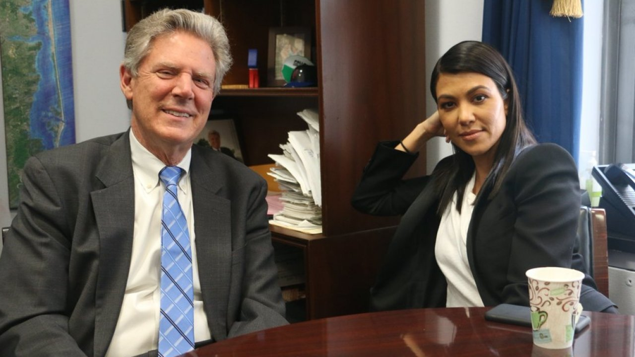 U.S. Rep. Frank Pallone sits with Kourtney Kardashian.