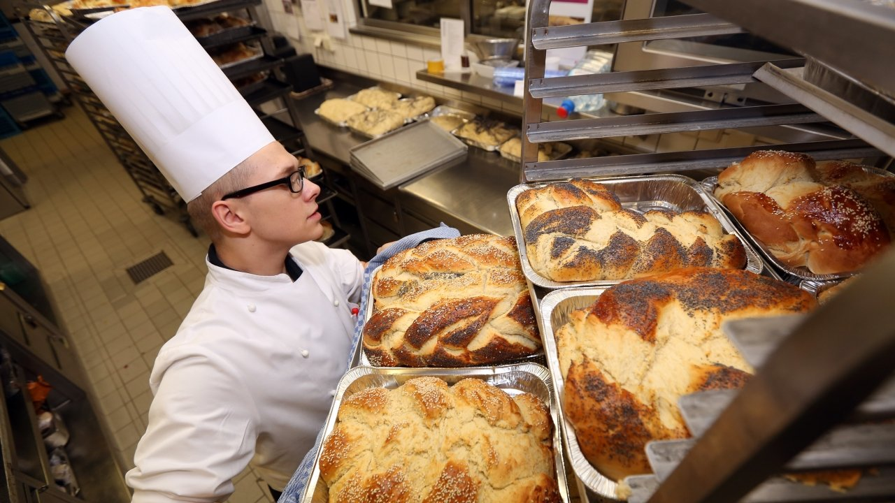 Chef handles trays of bread