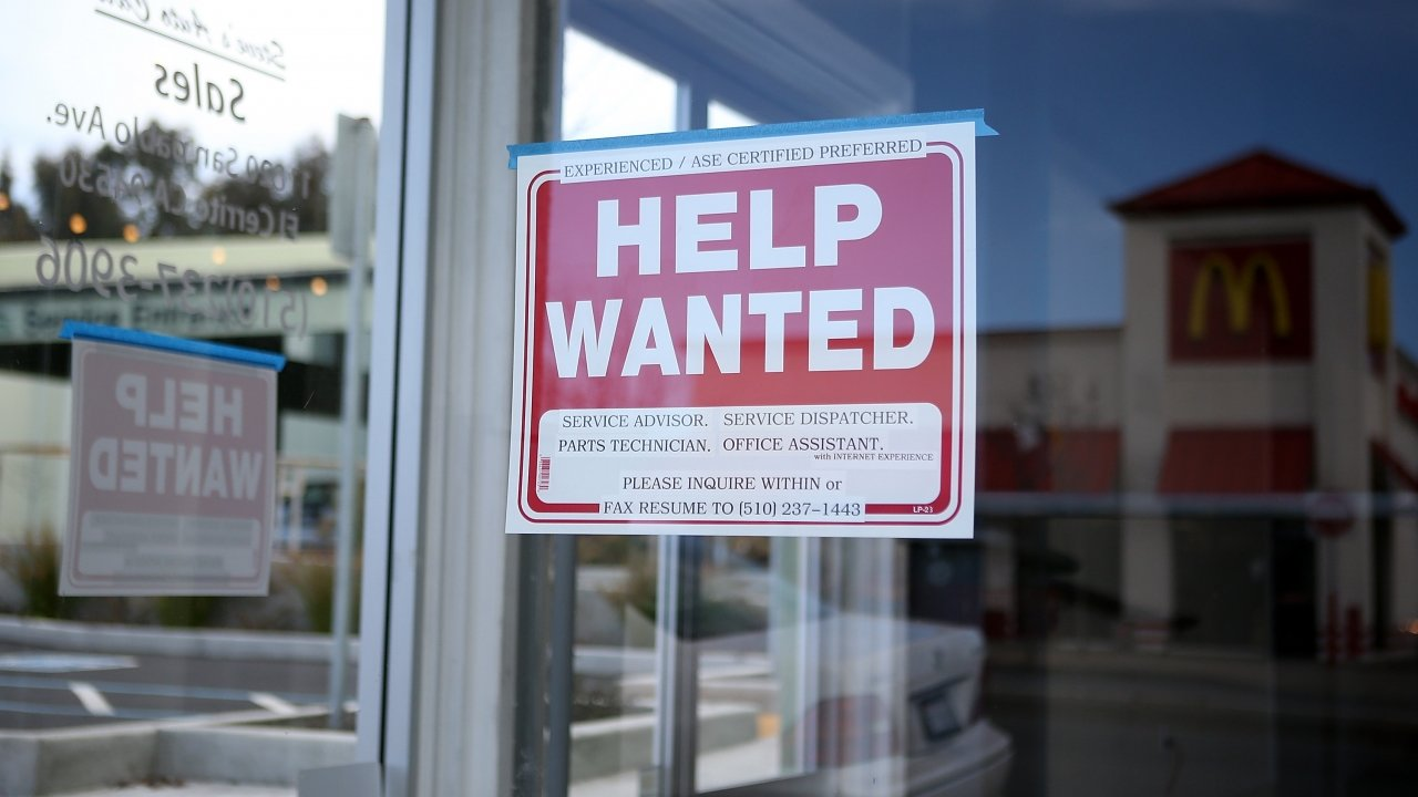 'Help Wanted' sign in a window