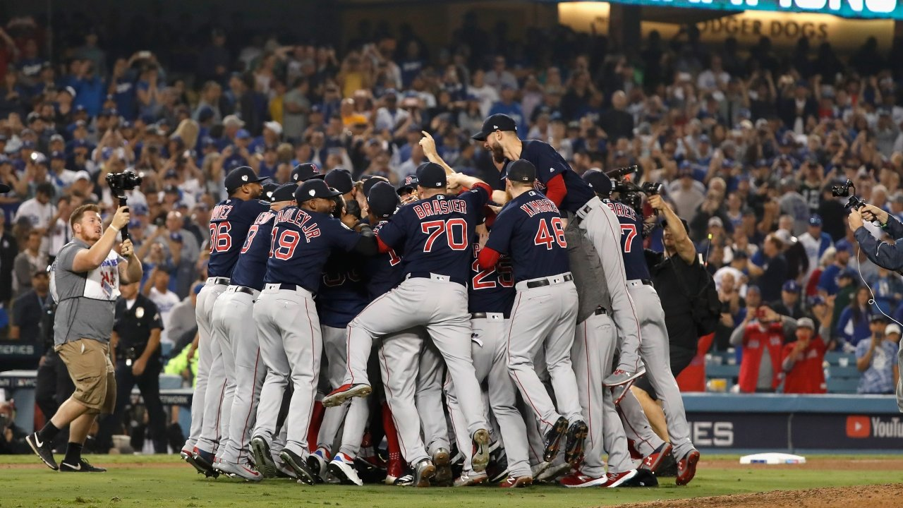 The Boston Red Sox celebrate their 5-1 win over the Los Angeles Dodgers.