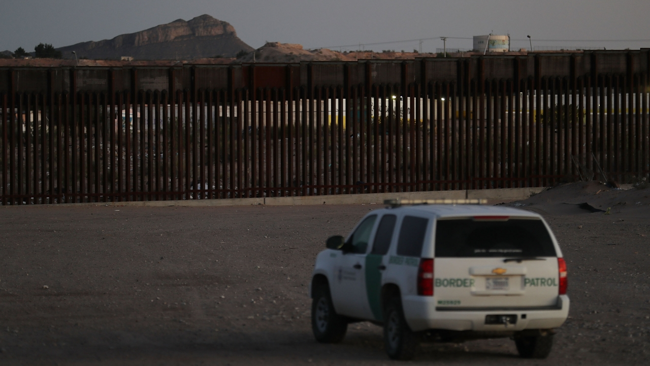 A U.S. Border patrol agent sits in his vehicle near the U.S.-Mexico Border in Sunland Park, New Mexico