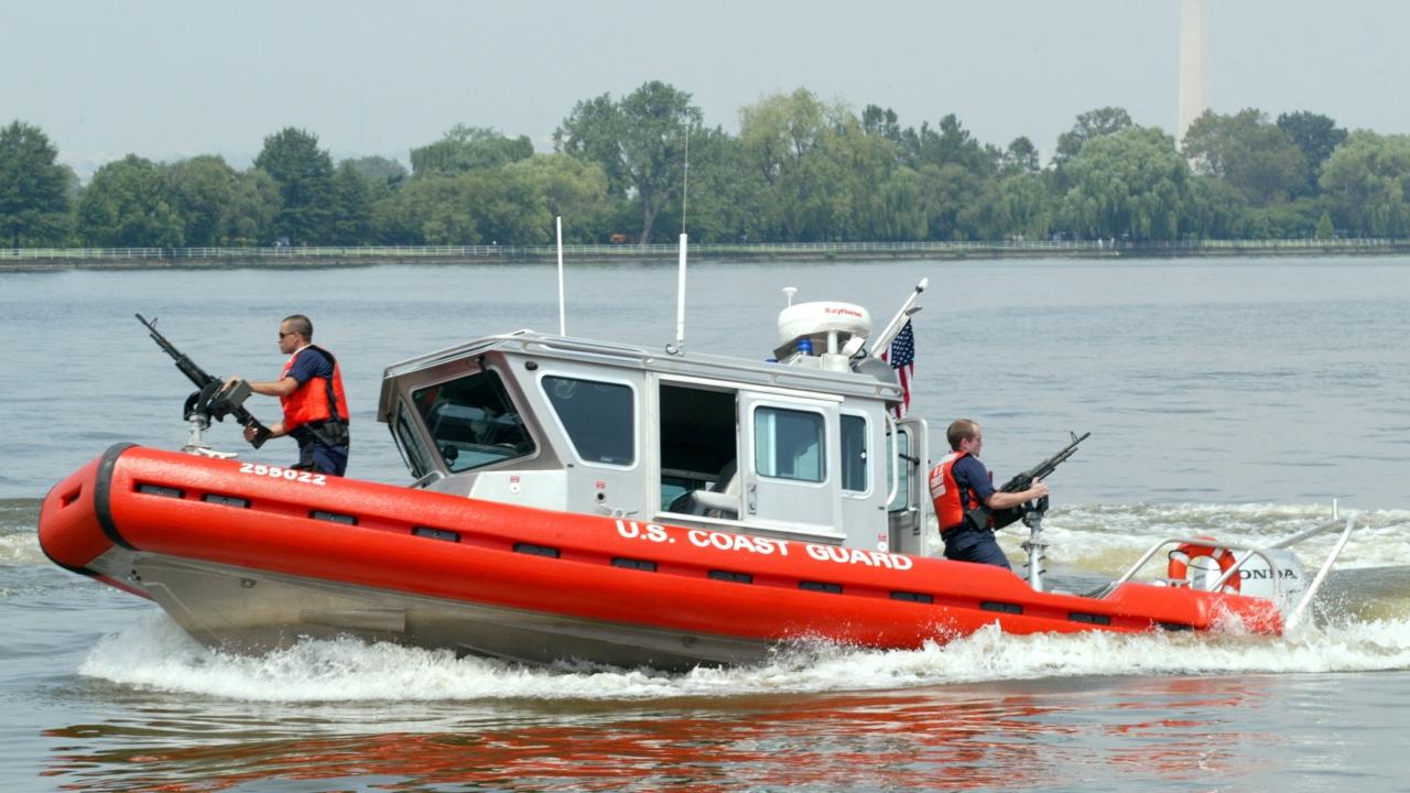 Members of the Coast Guard man a patrol boat