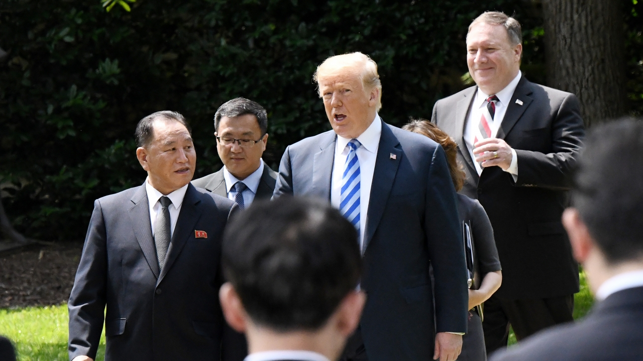 President Donald Trump walks with Kim Jong Un's envoy Kim Yong Chol and Secretary of State Mike Pompeo