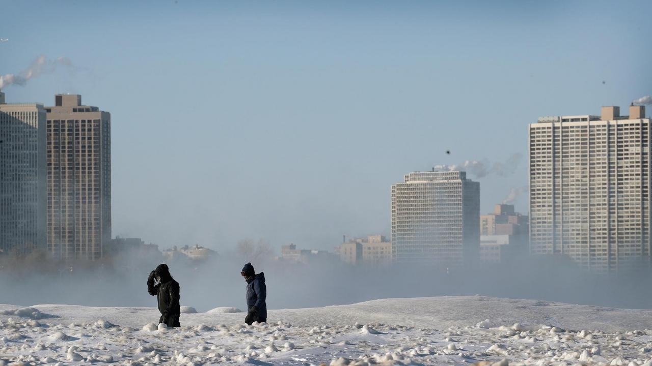 People walk along the Lake Michigan during a Polar Vortex